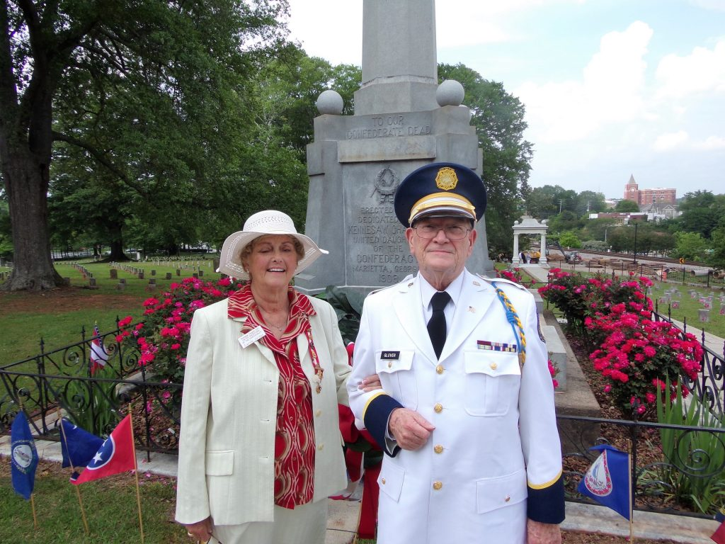 LTC Ross Glover, Old Guard representative and Mrs. Julia Sapp, President of the Kennesaw Chapter no. 241, United Daughters of the Confederacy stand before Confederate Memorial at the Confederate Cemetery in Marietta