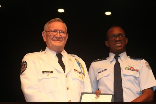 LTC Glover presents OG medal to Marietta HS cadet, Sgt. Devin Morrison.